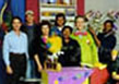 Actors Adrian Freeman and Clementine Mosimane with the crew of the e-tv series X-Peri Shop, recorded in studio, Pretoria